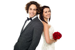 Love couple, back to back. Studio shot Royalty Free Stock Photos