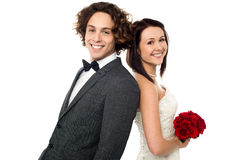 Love couple, back to back. Studio shot Stock Photo