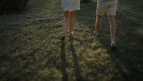 Love couple. Beautiful happy couple in love walking outdoors at sunset. Slow motion. stock footage
