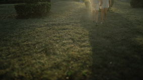Love couple. Beautiful happy couple in love walking outdoors at sunset. Slow motion.Tilt shift. stock footage