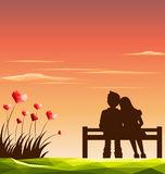Love couple on bench with polygonal heart shaped of wildflowers. Valentine day concept Royalty Free Stock Photos