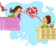 Love couple blowing heart in balcony Stock Photo