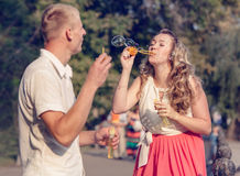 Love couple blowing the soap bubbles Royalty Free Stock Image