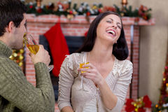 Love couple in Christmas night. Toasting with champagne royalty free stock photos