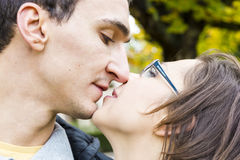 Love couple. Closeup kissing against nature background Royalty Free Stock Photos