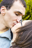 Love couple closeup kissing looking happy. Close up Royalty Free Stock Photo