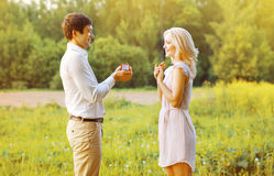 Love, couple, date, wedding concept - Man proposing ring woman. Love, couple, date, wedding concept - Man proposing ring women outdoors Royalty Free Stock Images