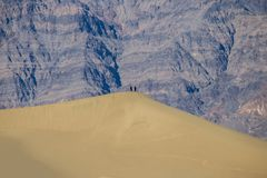 Love couple - desert life - mountains in the background royalty free stock photography