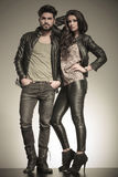 In love couple dressed in leather clothes. In a fashion pose in studio Stock Photos