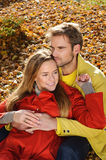Love couple embracing and loving in season - autumn park, coloursfull leaves, pregnant woman, smiling healthy couple, sunny day Stock Image