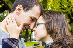 Love couple embracing outdoor looking happy Stock Photo