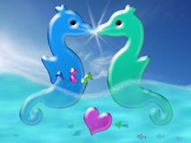 Valentine family. Two colorful seahorses kissing, provoking a light flash. The male is carrying three baby seahorses in his abdominal pouch Royalty Free Stock Image