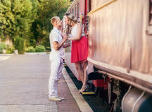 Love couple farewell moment on the retro railway Station Royalty Free Stock Images