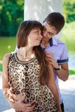In love couple flirtation in a summer sunny park Stock Photography
