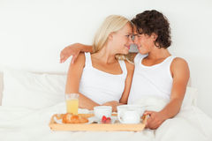 In love couple having breakfast. In their bedroom stock images