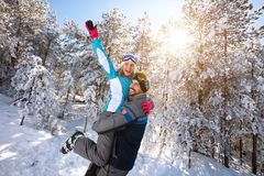 Love couple having fun in winter nature. Cheerful love couple having fun in winter nature Royalty Free Stock Images