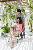Love couple at home.  Young asian relaxing on a balcony's garden Royalty Free Stock Images