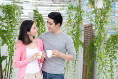 Love couple at home.  Young asian relaxing on a balcony`s garden Royalty Free Stock Photos