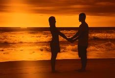 Love couple on honeymoon at beach Stock Photos