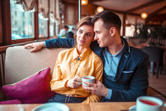 Love couple hugs and looking at the window Royalty Free Stock Images