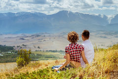 Love couple hugs mountain backdrop summer Royalty Free Stock Photography