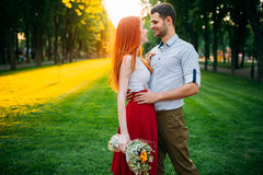 Love couple hugs on sunset, romantic meeting Stock Photography