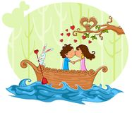 Love couple kissng in boat Stock Images