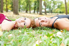 Love couple lying on grass Stock Images