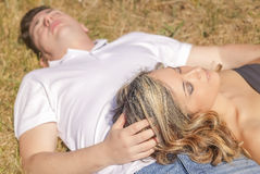 Love couple lying on the grass in a summer day Stock Photo