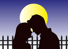 Love Couple At Night. Vector illustration of young love couple at night silhouette with a fence and moon Royalty Free Stock Image