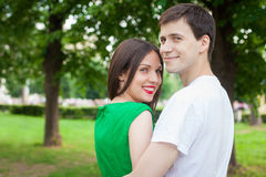 Love couple out in the park embrasing each other Royalty Free Stock Images