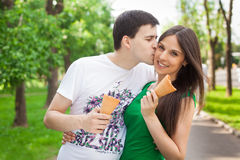 Love couple out in the park with ice cream kissing Royalty Free Stock Image
