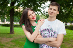 Love couple out in the park with Royalty Free Stock Photography