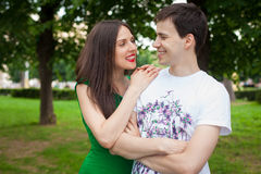 Love couple out in the park with Royalty Free Stock Photos
