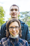 Love couple outdoor looking happy. Portrait of love couple outdoor looking happy Royalty Free Stock Photo