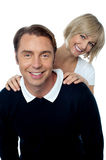 Love couple posing casually in front of camera Royalty Free Stock Photos