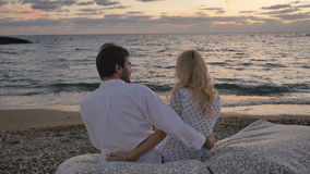 In love couple quarrels near the ocean stock footage