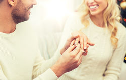 Man giving diamond ring to woman for christmas royalty free stock photography