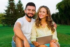 In love couple relaxing in the park. Royalty Free Stock Image