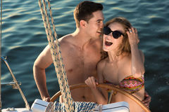 In love couple relaxing on a yacht. Stock Photo