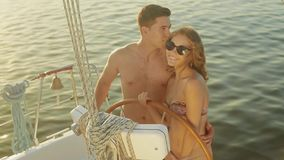 In love couple relaxing on a yacht. Guy and the girl at the resort. Loving couple spend the weekend on a yacht. Traveling on a yacht on the ocean. Leisure at stock video
