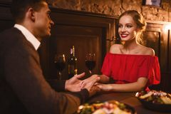 Love couple in restaurant, romantic evening Stock Images