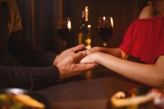 Love couple in restaurant, romantic evening Royalty Free Stock Images