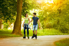 Love couple ride rollerblades Stock Photography