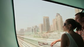Love couple ride on a train Dubai Metro in a summer day 1 stock footage