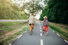 Love couple riding on vintage bikes Stock Photography