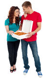 Love couple sharing pizza. Enjoying together Royalty Free Stock Images