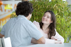 Love couple in shopping center sitting at the table Royalty Free Stock Photography