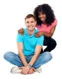 Love couple sitting on floor Royalty Free Stock Photo
