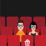 Love couple sitting in movie theater. Film show Cinema background. Viewers watching movie in 3D glasses. Popcorn box on red seat. Royalty Free Stock Photography